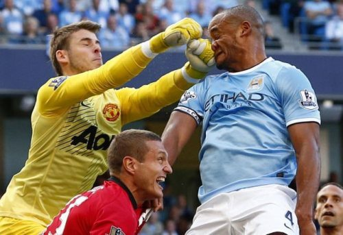 nicely_timed_sports_photos_soccer_goalie_punch_player_in_the_face