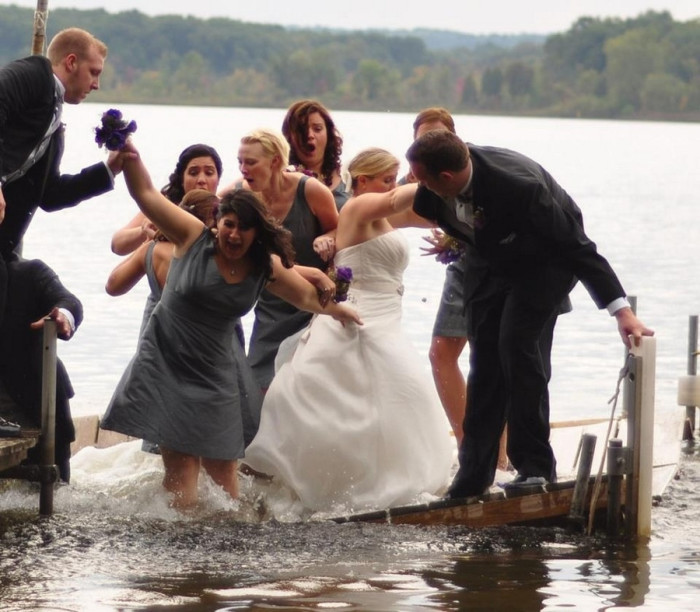 the_dock_under_a_wedding_party_gives_way_the_moment_their_picture_was_taken-700x612