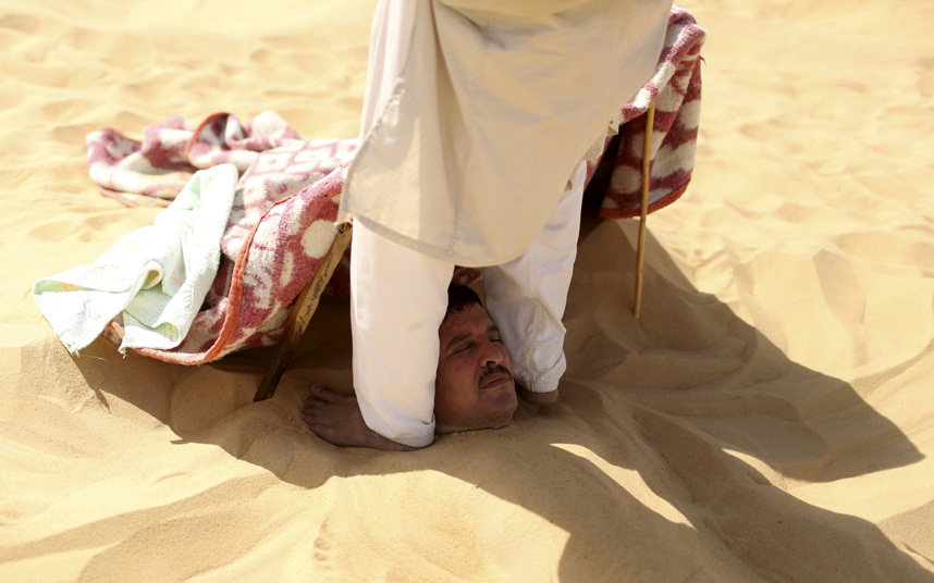 Wider Image: The Hot Sand Baths of Siwa
